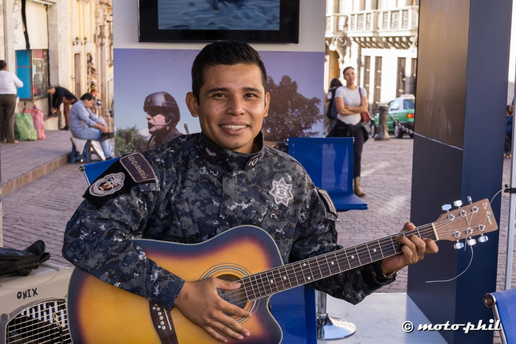 Mexican police agent in camouflage with guitar