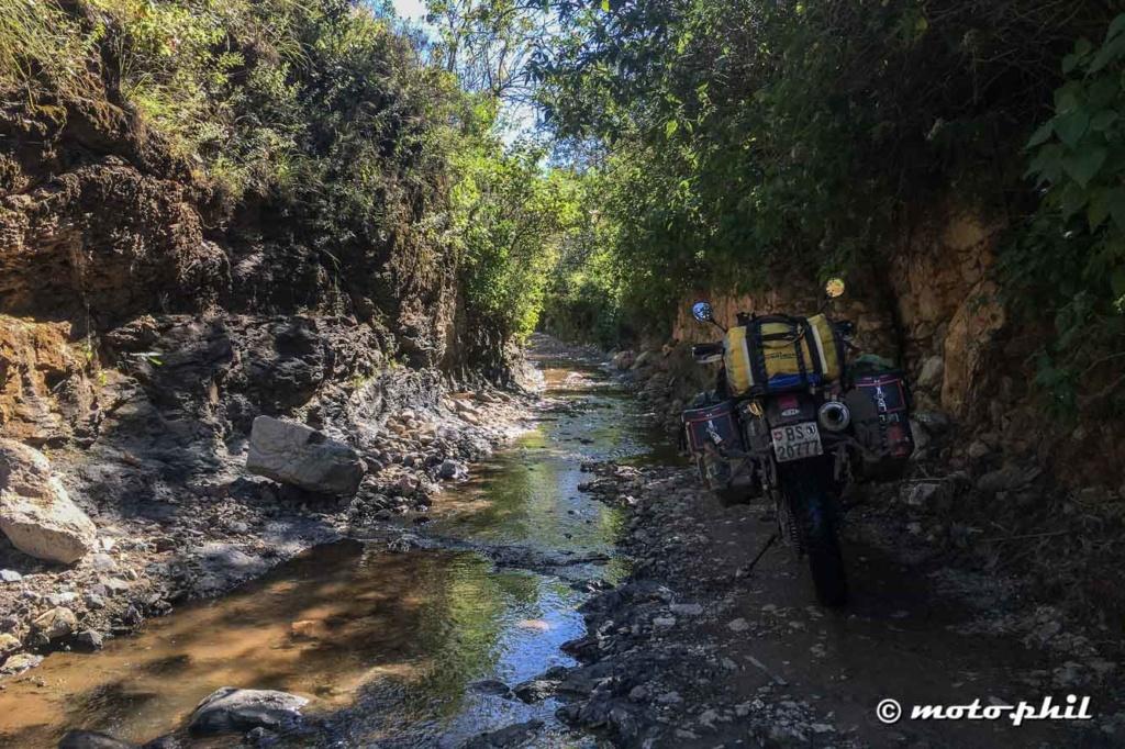 moto.phil's DR650 in a road that follows through a creek